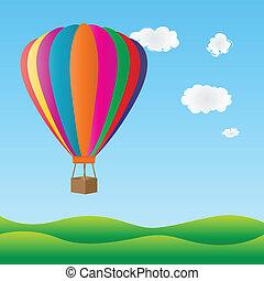 Colorful hot air balloon - Hot air balloon flying over green...