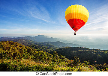 Colorful hot air balloon over mountain