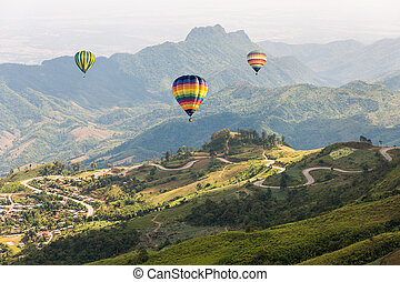 colorful hot air balloon over the mountain