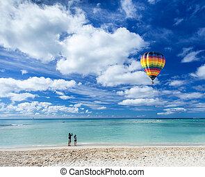 Colorful hot air balloon over Waikiki beach with blue sky background, Hawaii