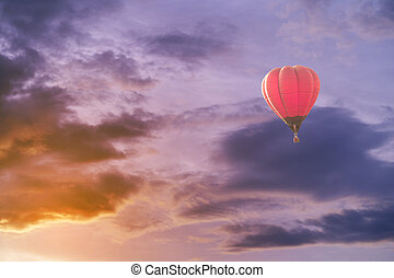 Colorful hot air balloon with dramatic sky at sunset