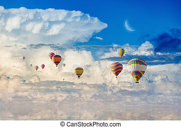 Colorful hot air balloons flying blue sea
