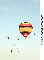 Colorful hot air balloons flying in the distance