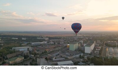 Colorful hot air balloons flying over green park and ...