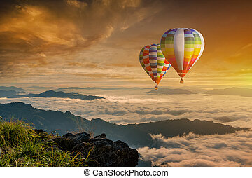 Colorful hot-air balloons flying over the mountain at Phucheefa, Chiangrai province ,North of Thailand.