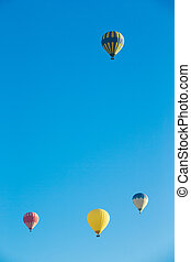 air balloons flying over the valley at Cappadocia