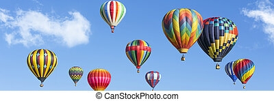 colorful hot air balloons - hot air balloons over blue sky