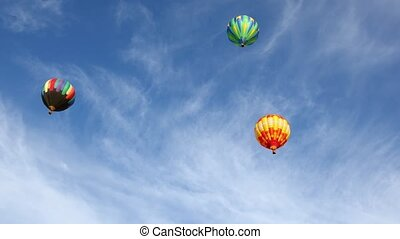 Colorful hot air balloons in blue sky, 4k