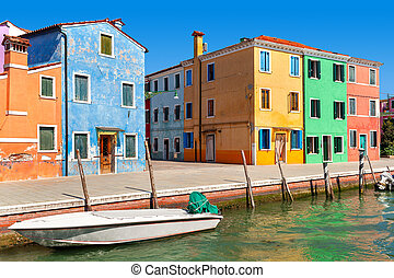 Colorful houses along canal in Burano, Italy.