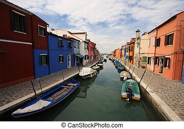 Colorful houses along one of the waterways of Burano, Venice. colorful houses on the island of Burano, off of Venice.