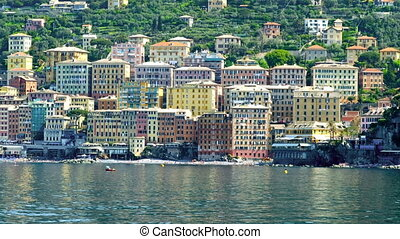 colorful houses facades typical buildings Camogli boat view...