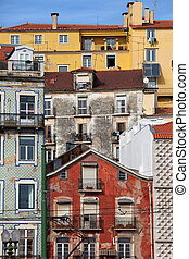 Old houses colorful facades in the Alfama district of Lisbon in Portugal.