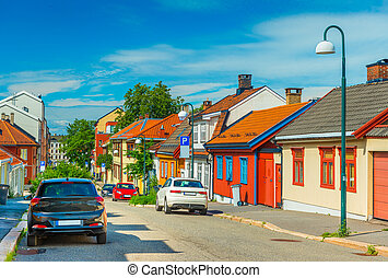 Colorful houses on a street in Oslo, Norway. Traditional Nordic wooden architecture