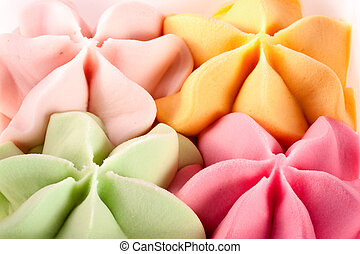 Colorful ice cream in the shape of a flower close-up top view
