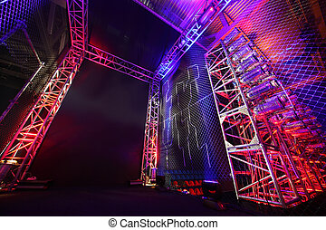 Colorful illuminated way with grid to boxing ring inside...