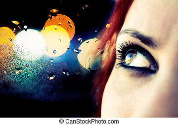 Colorful image detail of girl looking and abstract city lights