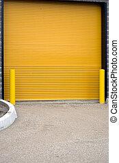 Colorful industrial orange garage door - A colorful...