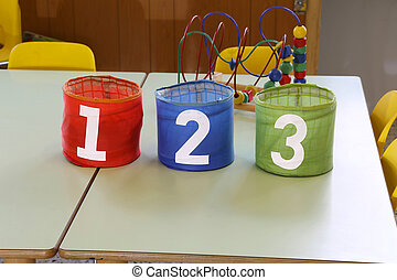 colorful jar with text one two three in the primary school