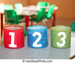 colorful jars with one two and three numbers in a school