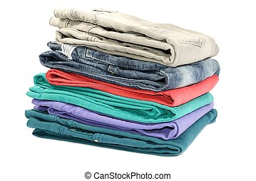 Stok of colorful folded jeans, closeup, on white background