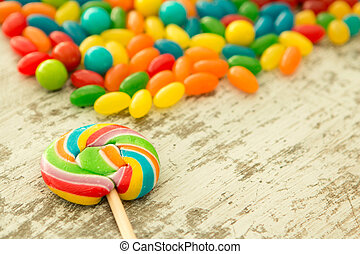 Colorful jelly beans and a lollypop - Colorful jelly beans...