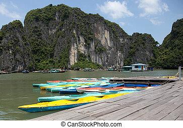 Colorful kayaks on the sea in Ha long bay Vietnam