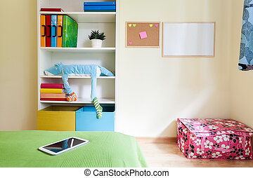Colorful kids room with white bookcase