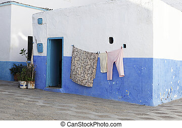 Colorful Laundry hanging outside of the house
