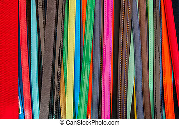 Colorful leather belts for women and men.