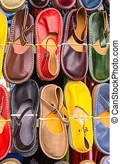 Colorful leather shoes on stall at the bazaar