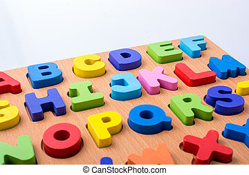 Colorful letter blocks on board on white