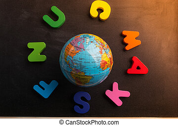 Colorful letters forming a circle around a globe