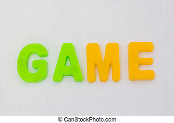 Colorful letters on white background. Kids plastic toy, learning english words in language school. Text game