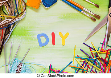 colorful letters with craft supplies, word diy, do it yourself