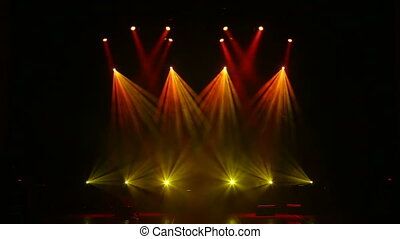Colorful light flashing and white rays on an empty stage in the dark.