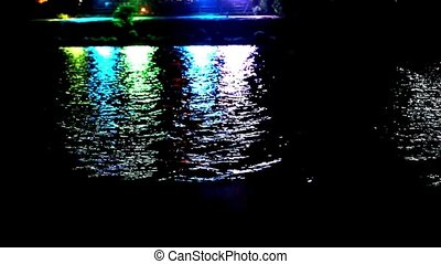 Colorful light reflect on the water at night. Video shift motion 1920*1080