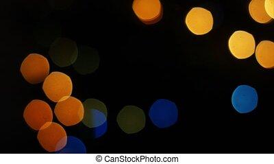 Colorful lights bokeh on black background. Dynamic