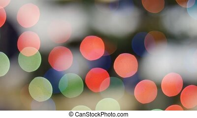 Colorful lights bokeh on black background. Loop