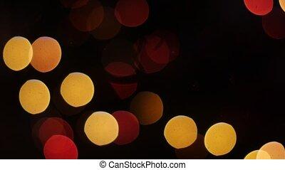 Colorful lights bokeh on black background. Static