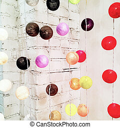 Colorful lights decorating a brick wall