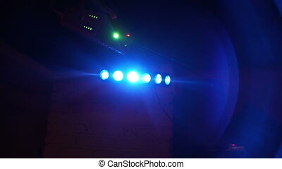 Colorful lights in night club close up. Professional color lighting and effects. Stage lights background on night concert show.
