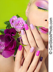 Colorful lilac manicure and lips.