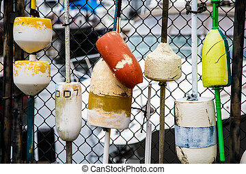 Colorful Lobster Buoys on Fence