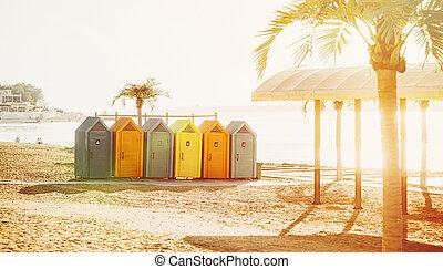 Colorful locker rooms on beach in summer sunny day. Resort city Gelendzhik.