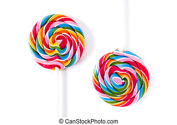 Colorful lollipops isolated on white background. Top view.