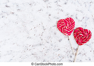 Colorful lollipops on white background. Top view