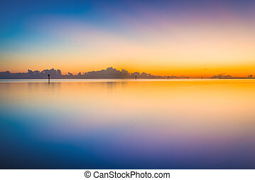 Colorful long exposure taken from Smathers Beach at sunset, in Key West, Florida