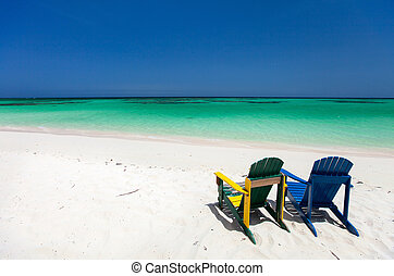 Colorful lounge chairs at Caribbean beach
