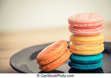 Colorful macaron in black dish on wooden floorin Vintage theme 2