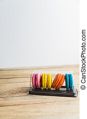 Colorful macaron in plastic box on wooden floor 2